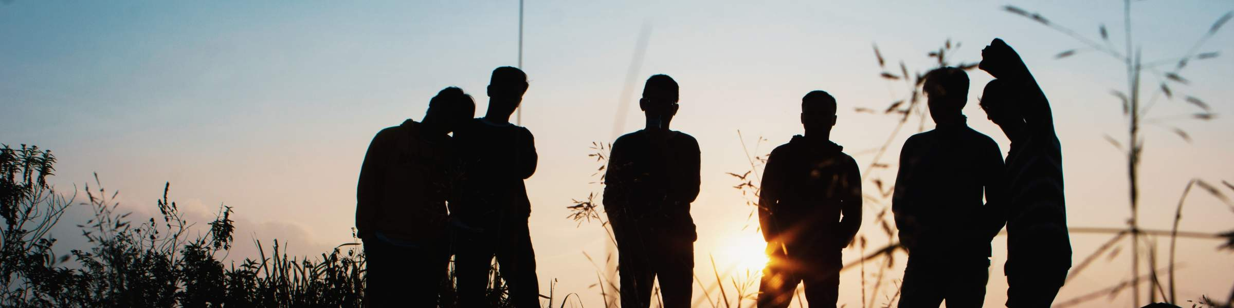 Young people with sunset